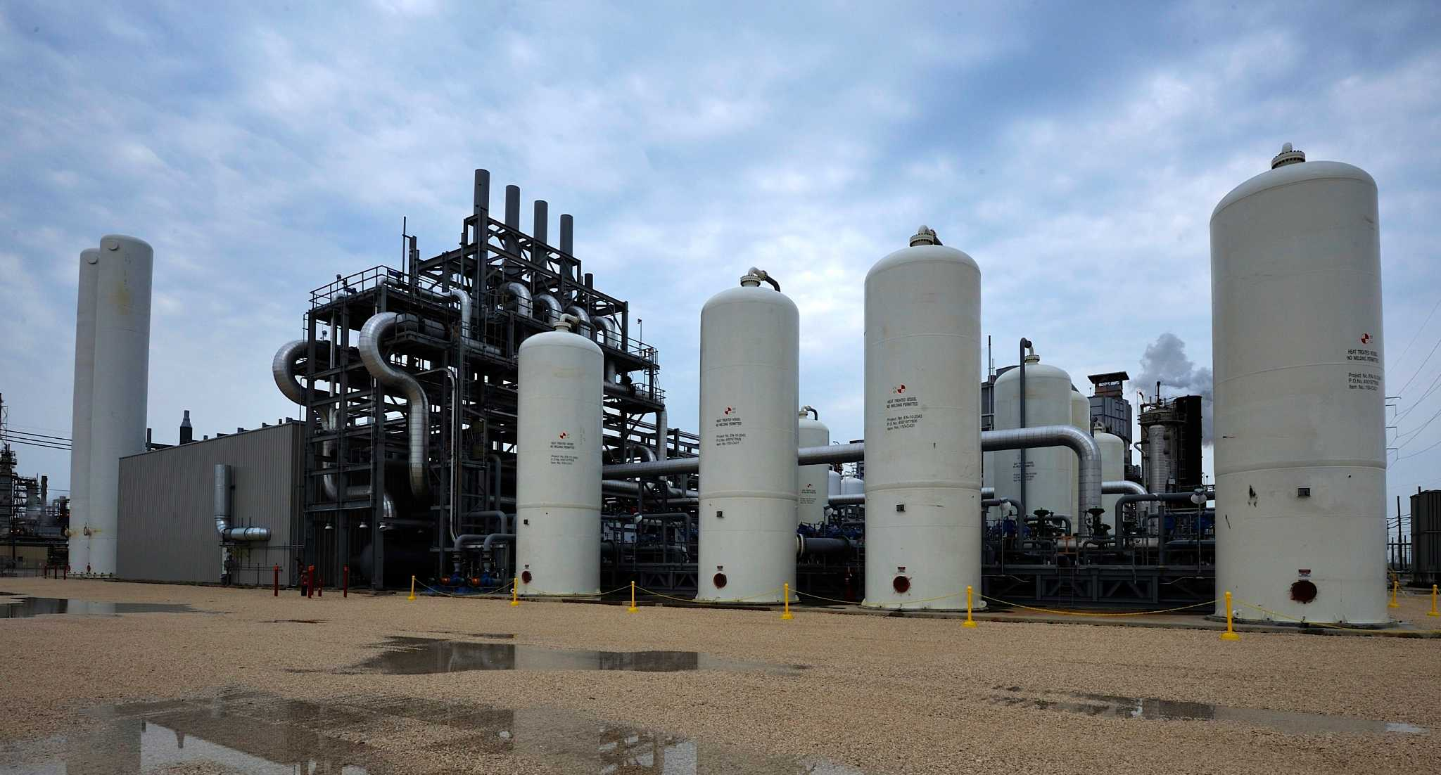 In a $400 million demonstration project supported by federal funding, this Air Products facility captures carbon dioxide emitted at Valero Energy s refinery in Port Arthur and pipes the gas to help push oil out of an aging field south of Houston. (Air Products photo received 6/5/2014)